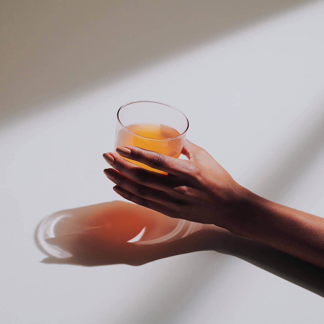 Hand with a glass of Vitality